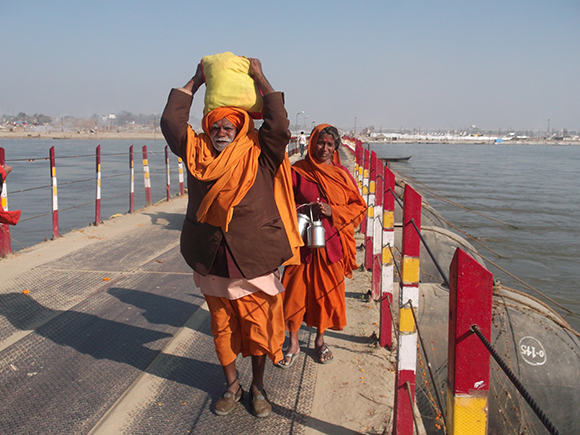 Pilgrims crossing Pontoon bridge to take bath in Maha Kumbh mela.