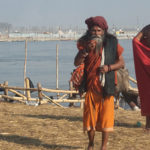 Sadhus dressing up after bath in Triveni Sangam