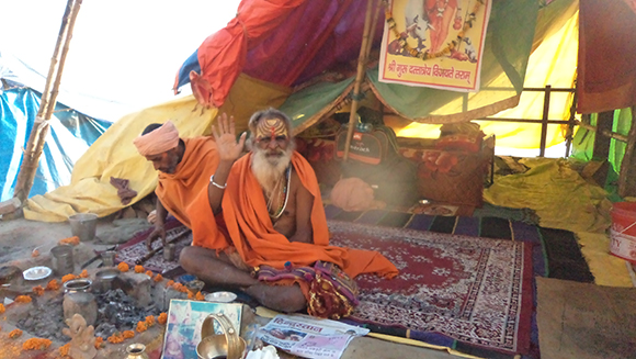 Sadhu blessing the pilgrims