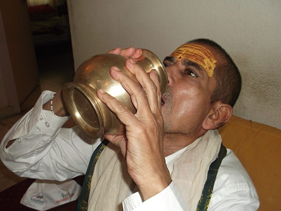 Hindu Priest Using Antique Brass Pot for Drinking Water.