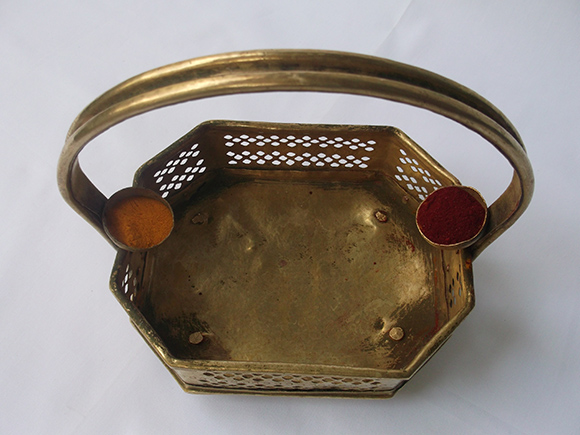 Two Small Bowls Riveted to the Handle Filled with Pasupu and Kumkum