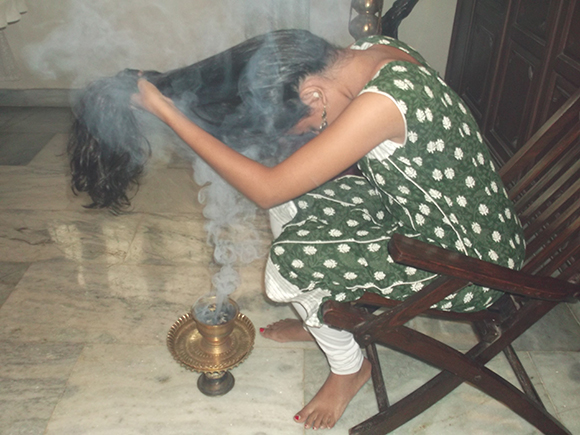 Smoke from sambrani drying the frontal portion of hair.