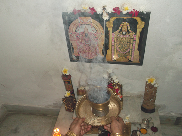 Sambrani dhoop offering to the God.
