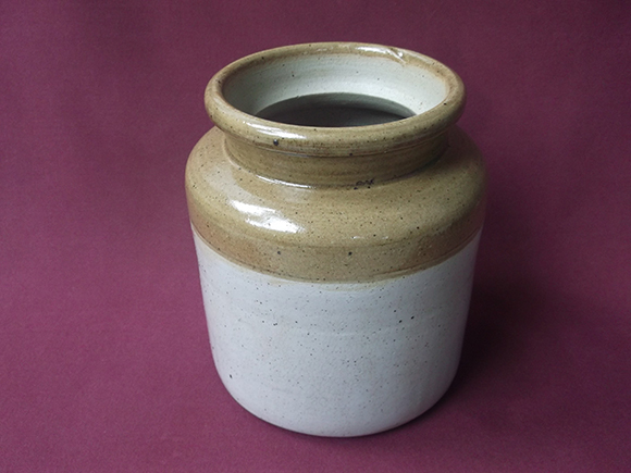 Close up view of the  porcelain pot (also known as Jaadi) used for churning the lassi.