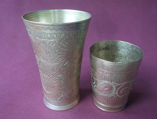 Large and small brass lassi glasses shown together.