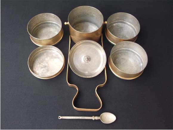Tiffin carrier shown in dismantled condition-five dabbas, top lid, frame and spoon