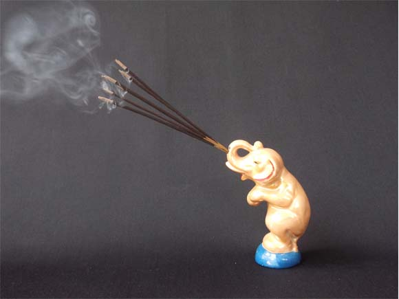 Antique elephant incense stick holder-with burning sticks and curls of smoke