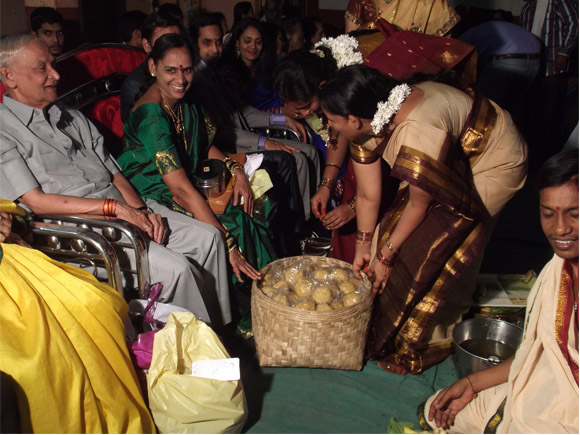 Marriage function bride's family gifting sweet laddus to groom's family