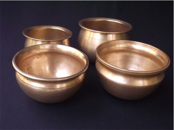 Antique Brass and Bronze curry pots in a group