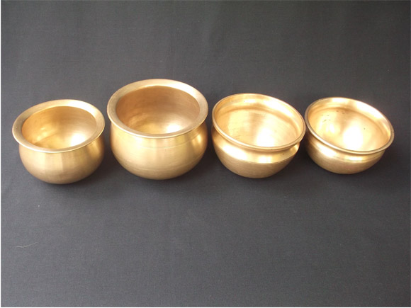 Antique Brass and Bronze curry pots in a row