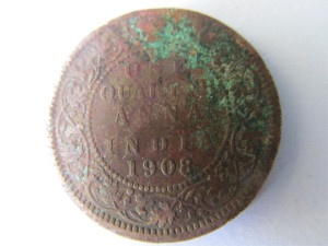 Year 1908 copper coin with multi-colour toning
