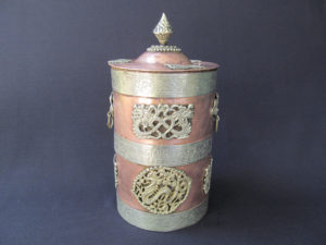 Mystical copper vessel with 3 white metal strips, dragon embellishments and the lid with the knob