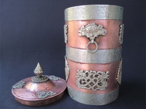 The cylindrical shaped Mystical copper vessel and the lid shown separately
