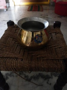 The vessel coated inside with tin layer, I use to cook Sambar and Andhra pulusu