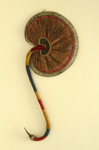 A hand-held fan made out of fragrant roots called VattiVeru resembling the design of the antique brass hand-held fan