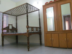 Mix of antique four post canopy cot with new wardrobe with mirrors