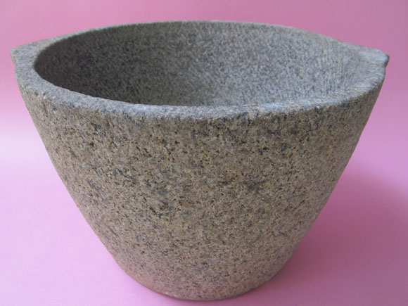 Storage pot carved out of single piece of granite stone