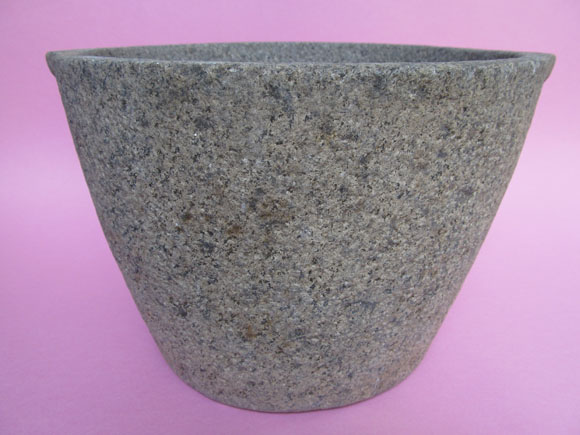 Handmade stone pot created with simple tools of a chisel and hammer