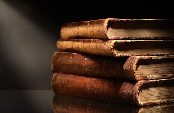 Light reflecting on old antique books
