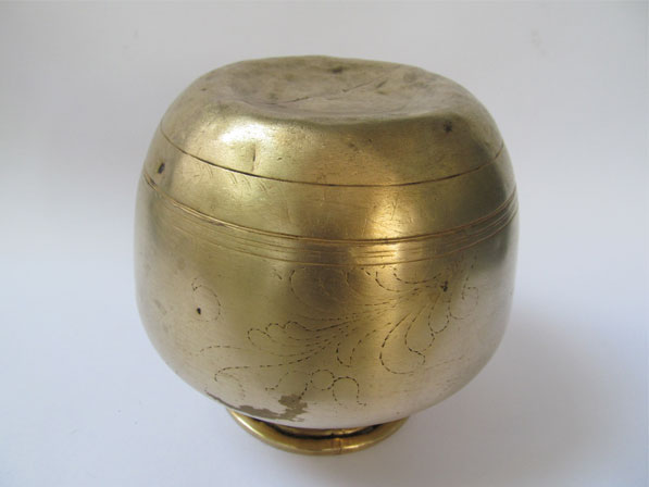 antique fire walking brass pot with depression for resting on the head.